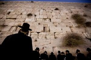 Yom Kippur: An Orthodox Jewish worshipper prays at the Western Wall before Yom Kippur