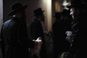 Yom Kippur: Ultra-Orthodox Jewish men perform the Kaparot ceremony
