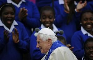 Pope Day 2 Twick: Pope Benedict XVI smiles during a tour in Twickenham