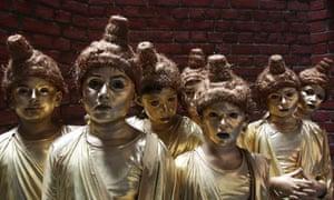 Indian children dressed as Buddha