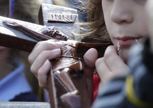 Pope 3: A child  holds crucifix during Pope Benedict XVI visit