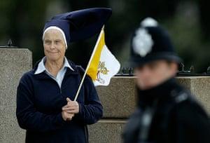 Pope 3: A nun waits on Lambeth Bridge, where Pope Benedict