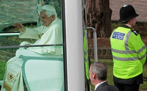 Pope 4: A British police officer stands guard