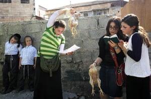 Yom Kippur Update: Twirling chickens to rid one of sins before the start of Yom Kippur