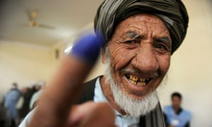 Afghanistan elections: A man shows his inked finger at a polling station in Kabul