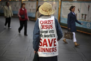 Pope in London: Woman hands out leaflets to passers by before a mass with Pope Benedict XVI