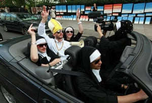 Pope Day 2: Anti-Pope protestors drive in an open top car near Hyde Park