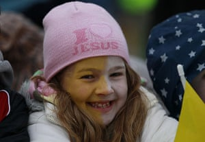 Pope visit day 4: A young pilgrim smiles as she waits for Pope Benedict