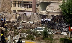 Iraqi security inspect scene of an explosion in residential district of Mansour, Baghdad