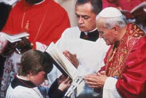 Pope 1982 Visit: Pope John Paul II reads from a book held by a choirboy