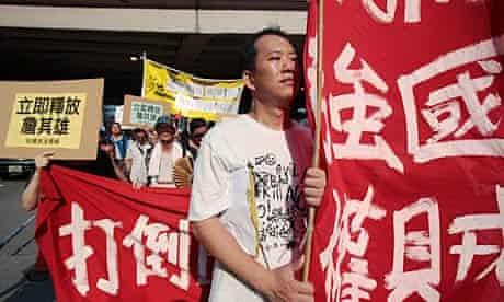 Anti-Japan protesters chant slogans during a rally in Hong Kong