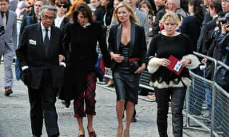 Kate Moss arrives at the memorial service for fashion designer Alexander McQueen
