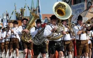 Oktoberfest in Munich: A traditional brass band takes part in a parade as Oktoberfest kicks off