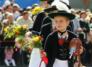 Oktoberfest in Munich: Girls in traditional Bavarian outfit participate in the riflemen's parade