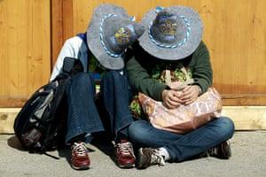 Oktoberfest in Munich: A drunk couple wearing Oktoberfest 2010 hats during day two