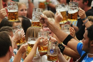 Oktoberfest in Munich: Visitors toast with beer mugs during the opening day of the Oktoberfest
