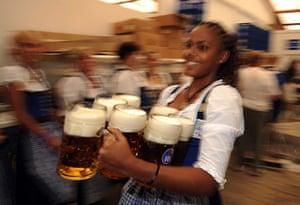 Oktoberfest in Munich: A waitress carries seven beers as the 2010 Oktoberfest kicks off