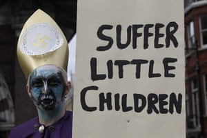 Pope Protestor: A demonstrator holds a banner during a protest against the visit of Pope