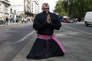Pope Protestor: A demonstrator takes part in a protest