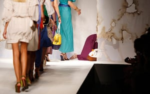 Milan Fashion Update: A model falls at the end of the catwalk during the Fendi Spring-Summer 2011