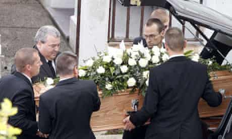 The coffin of MI6 worker Gareth Williams is carried out of a hearse in Holyhead for his funeral