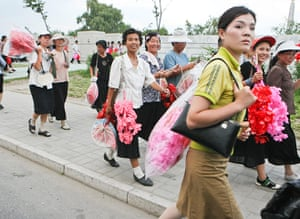 North Korea: Citizens leave to head home after rehearsing a parade at Kim Il-Sung Square