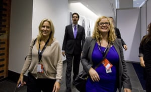 Labour party conference: Ed Miliband and Labour party officials leave the conference hall