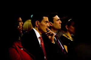 Labour party conference: David Miliband listens to his brother Ed Miliband's speech