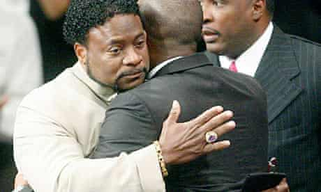 Bishop Eddie Long embraces a friend at his New Birth Missionary Baptist Church