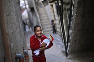 Muhammed Muheisen: Palestinian Fatima, 10, laughs with a friend while playing