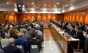 The 95 defendants in the Marbella corruption trial and their lawyers in a courtroom in Malaga
