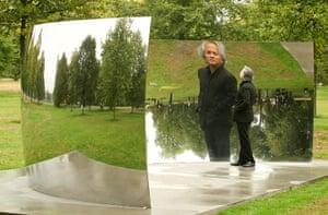 Kapoor: Artist Anish Kapoor is seen reflected in 'C-Curve' 2007