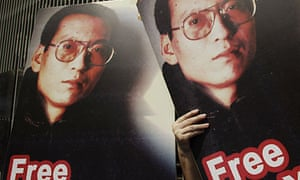 Pro-democracy activists hold pictures of Chinese dissident Liu Xiaobo