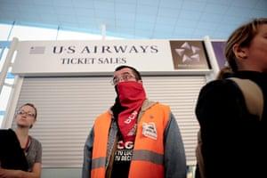 European strikes: A protestor looks on at the El Prat Airport in Barcelona, Spain