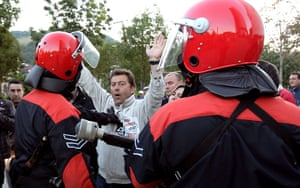 European strikes: Two Basque Regional policemen control a picket, Spain