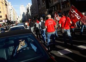 European strikes: A driver tries to drive along Madrid's Gran Via boulevard, Spain
