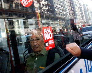 European strikes: Passenger looks on from inside a bus  picketer knocks on the window, Spain