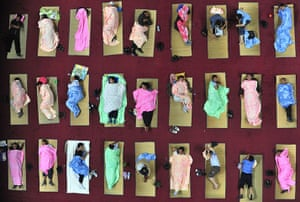 24 Hours: Parents of freshmen students sleep at a university campus in Wuhan, China