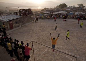 24 Hours: People play soccer in Port-au-Prince, Haiti as the sun sets