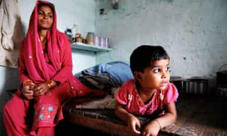 Selma Shakil, 27, with daughter Fizar, in slum in north west Delhi.
