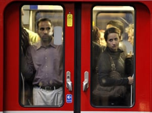 French Strikes: Commuters looks through the window of a subway train in Paris