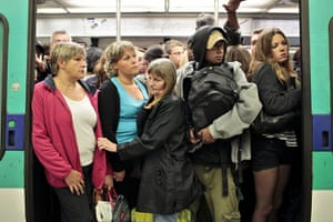 French Strikes: Commuters are seen in a crowded train of the Paris subway