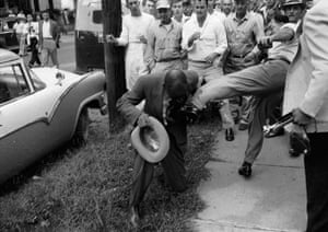 Little Rock: Civil rights journalist Alex Wilson is kicked by a member of a white mob