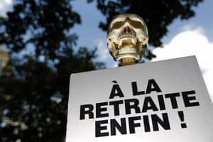French Strike Update: A skull on the top of a placard reading retired at last in Paris