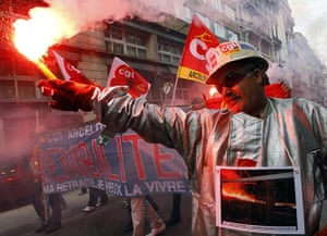 French Strike Update: Steel worker dressed in a protective suit demonstrates in Marseille