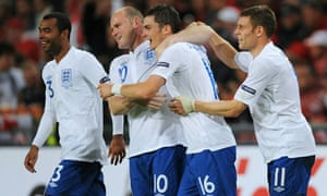 Wayne Rooney and his England teammates celebrate following their win against Switzerland