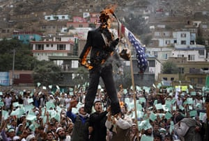 Quran Protest : An Afghani protester burns a portrait of Terry Jones