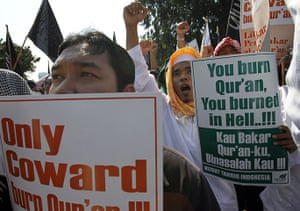 Quran Protest : Members of the Islamic group hold placards by the U.S. embassy in Jakarta