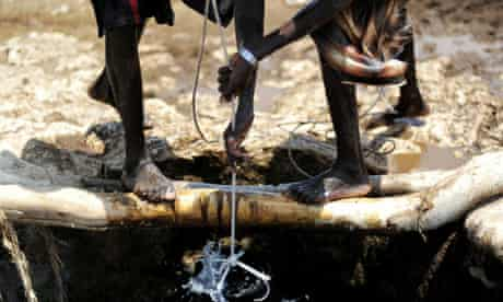Herdsmen at a well in Somalia where the government has called for aid funding to combat piracy