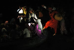 Pakistan Flooding Update: Flood affected villagers board a Pakistani navy boat as they evacuate